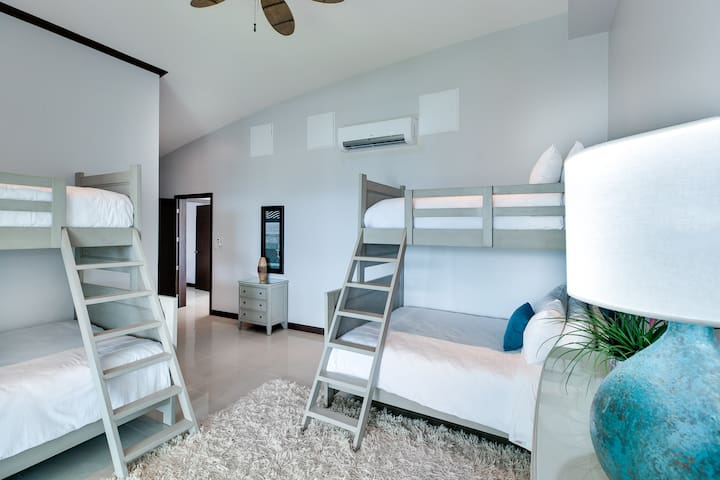 Fourth bedroom with private balcony.