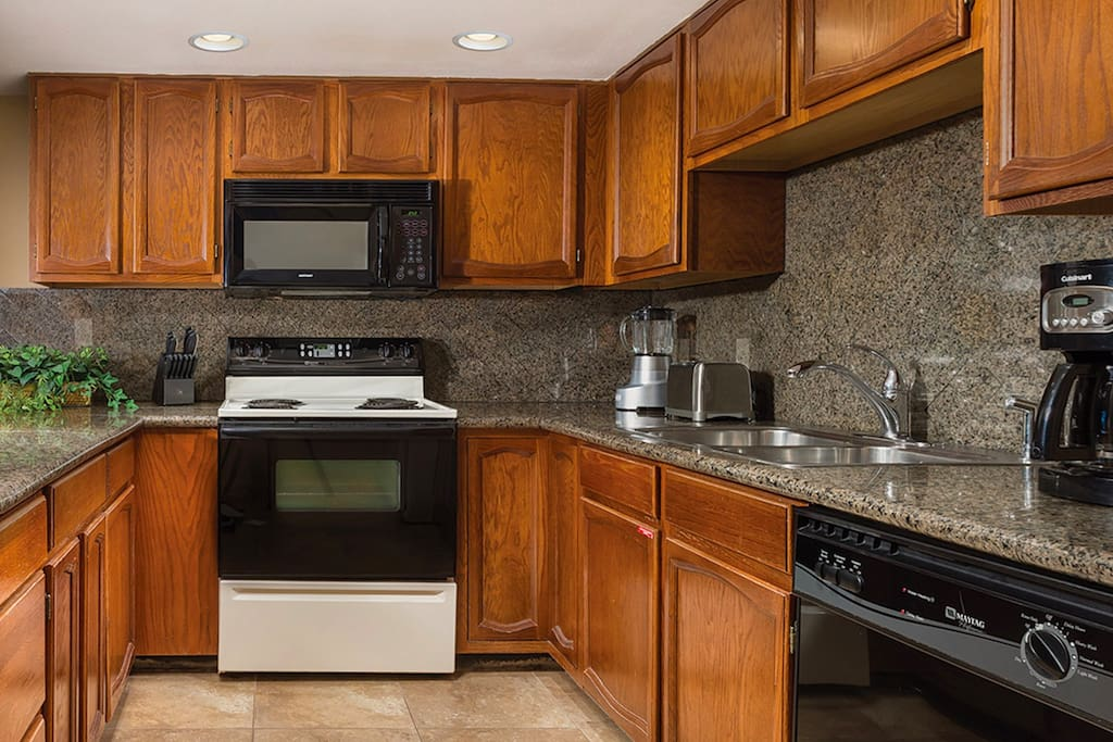 The richly-appointed kitchen is a joy to cook in