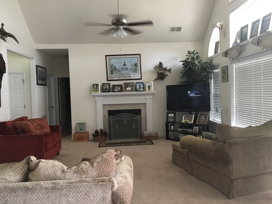 Den with fireplace and large tv