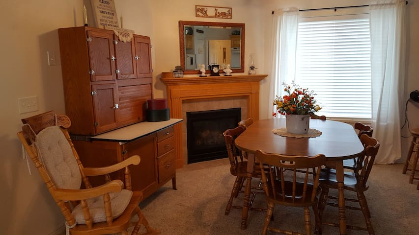 Sit and enjoy a meal by the cozy gas fireplace.