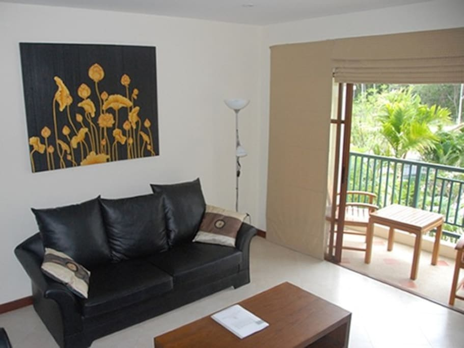 Lounge with large screen TV and HiFi opposite
