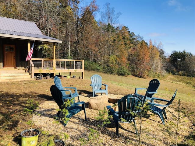 Comfy Cozy Cabin:  beautiful views, privacy galore, sitting on 13 acres with walking trails.  Pet friendly!