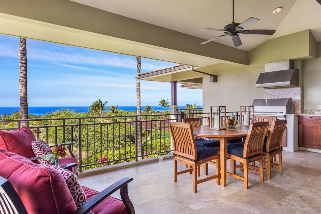 Lanai with loungers, barbecue grill, and dining area for six.