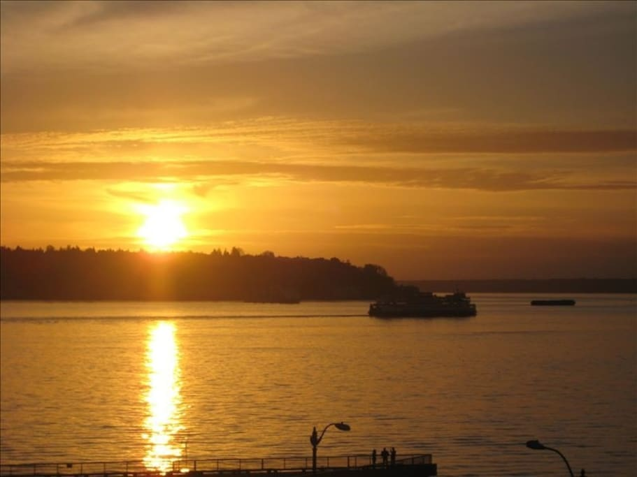 Sunset; ferry boat views await you from the living/dining room and master bedroom!