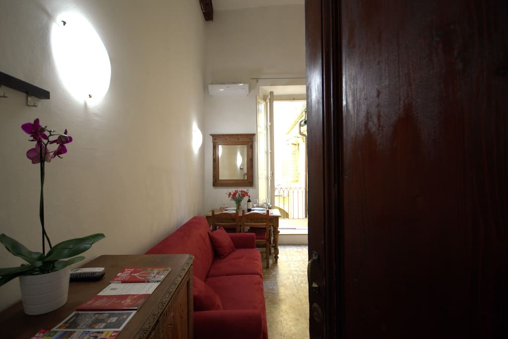 Living area with Sofabed for 2 persons, Air Conditioning, Lcd TV, Wifi internet, table and chairs, bathroom, little kitchen, balcony, stairs for the second level.
