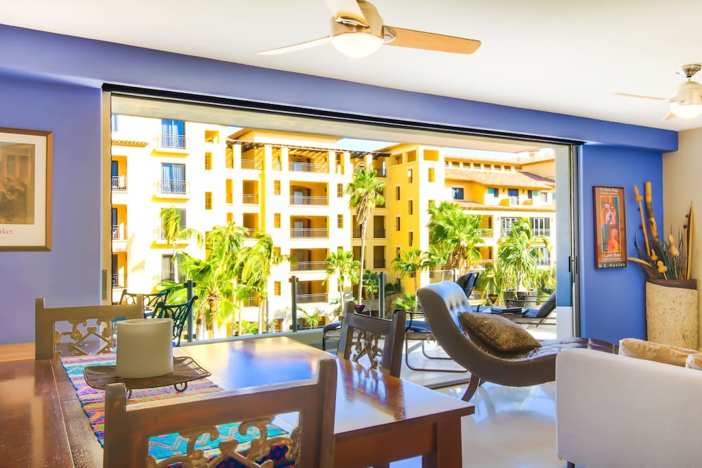 Living/Dining/ Kitchen with pocket doors to patio facing Ocean