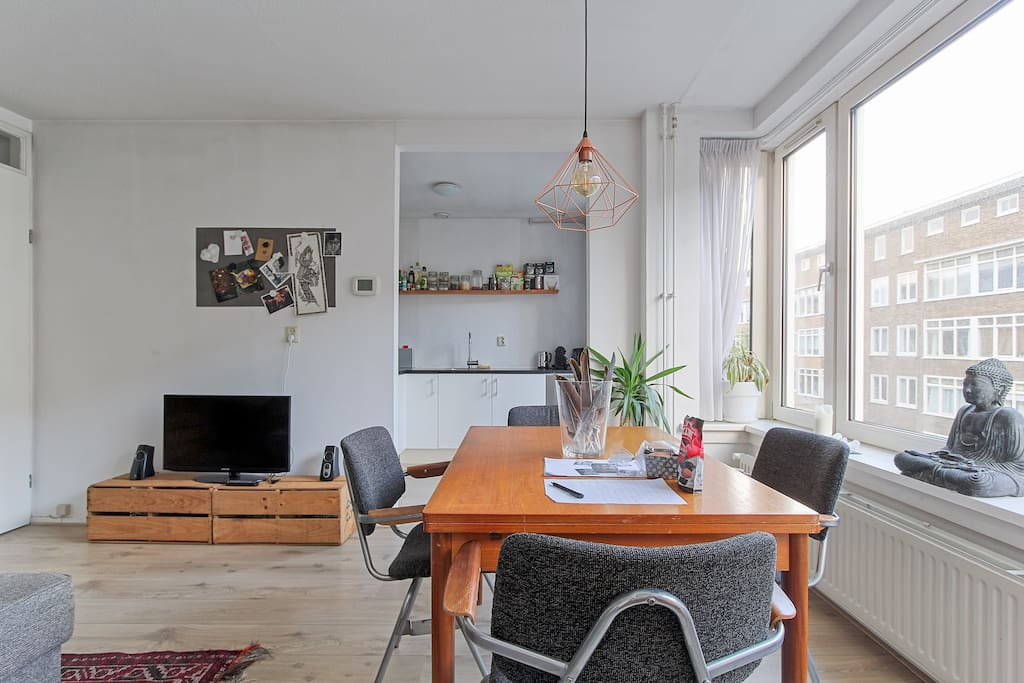Spacious living room and adjacent kitchen where you can dine with loved ones and chill after a day in the beautiful city center.