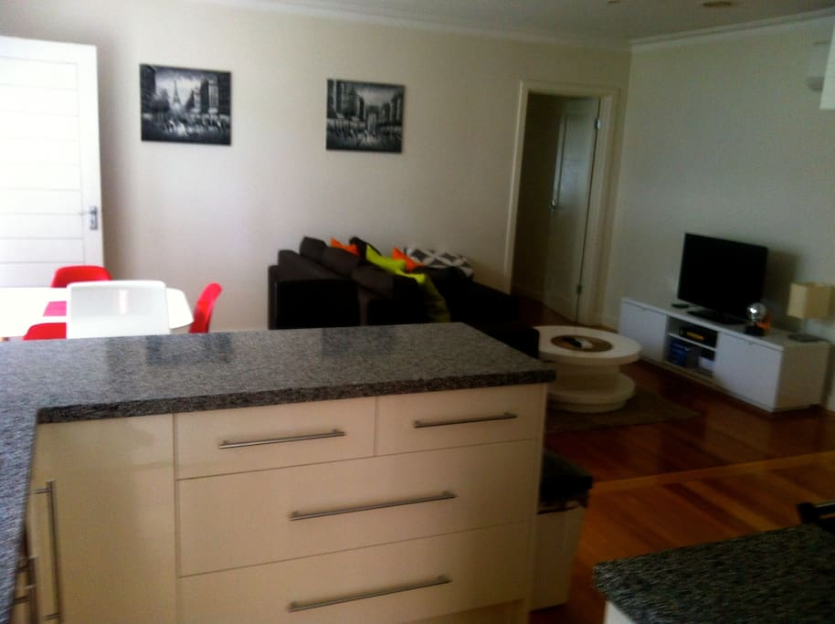 Spacious and modern open plan dining, living and kitchen area.