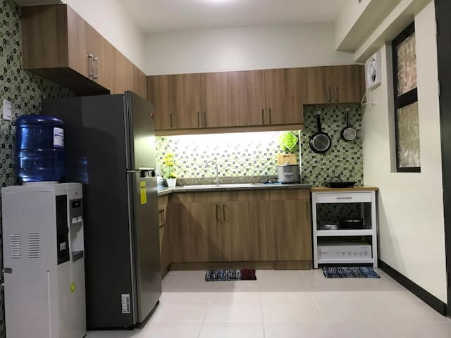 Our kitchen is equip with your basic needs: Water Dispencer with free 5gl of bottled water, 8.0 Cuft Fridge, Microwave Oven, Electric Kettle, Induction Cooker with complete cooking sets, kitchen utensils and cleaning agents...