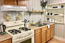 Fully equipped kitchen with gas stove