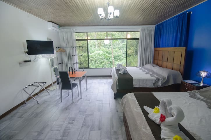 Family Room with 2 king beds at Volcano Gold Loft