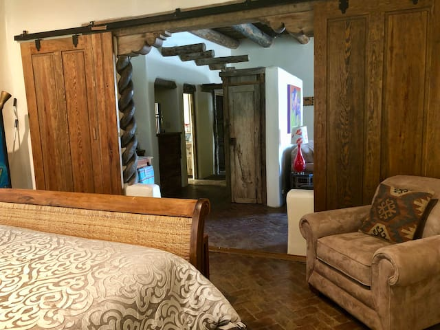 The bedroom has large rail doors with exquisite wood work.