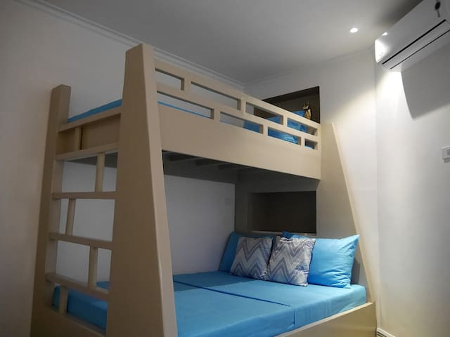 2nd Bedroom with 1 double-size bed and 1 single bed