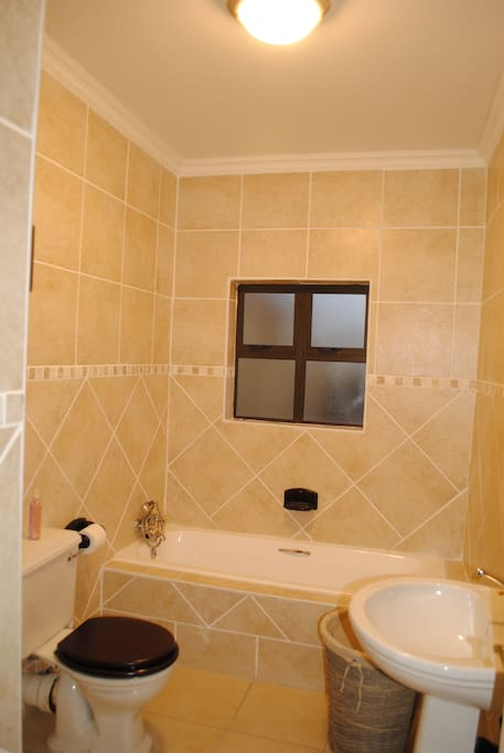 Main (on Suite) bathroom with a shower and bathtub