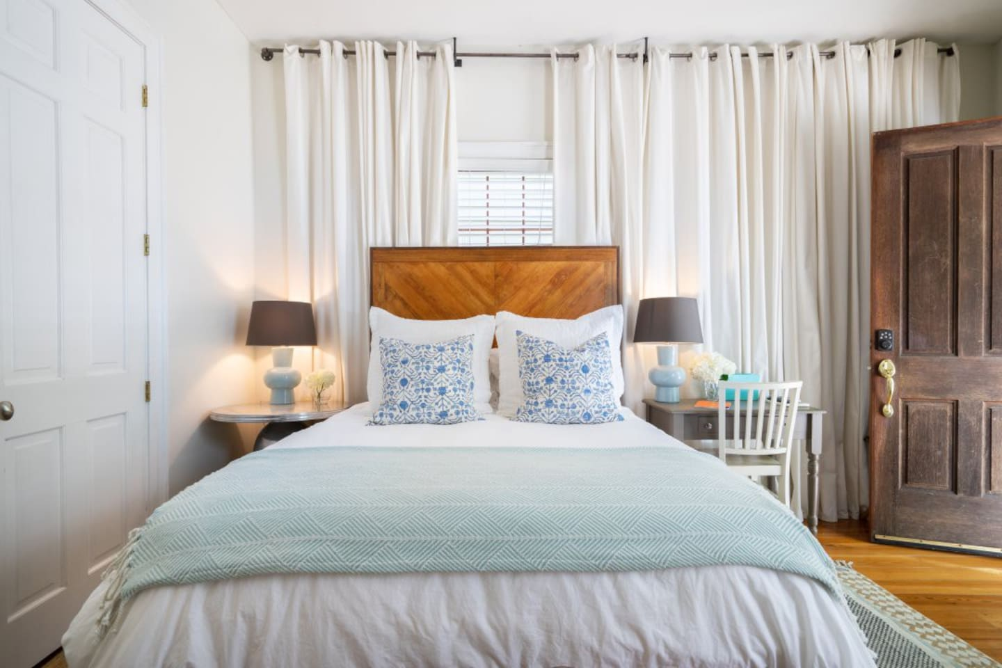 A luxury and private studio apartment, filled with light, steps from magazine street, and a bed made up with luxury linens.