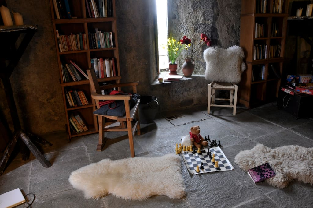 Game of chess   and sheepskin rugs Great Hall Ballyportry Castle