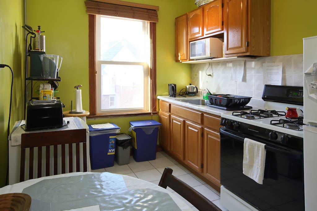 Kitchen showing fridge,microwave, toaster and electric kettle that can be used by guests.
