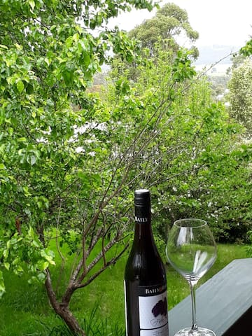 wine on the balcony over looking fruit  trees