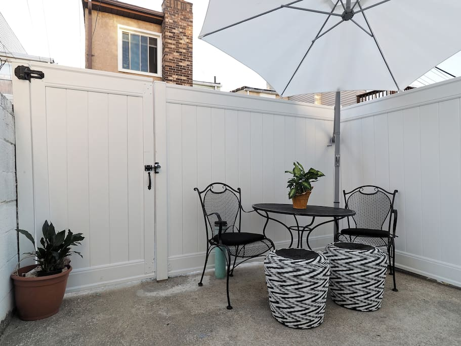 private backyard patio is a quiet respite from the excitement of federal hill!
