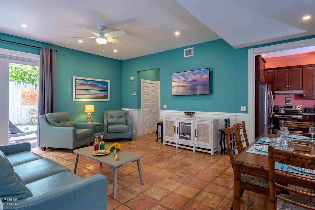 The spacious living area has a large mounted SMART TV...