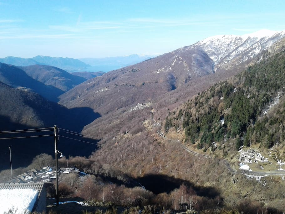"Our mountain village, named Indemini, can be seen in the centre of the photo, taken from ""Alpe Neggia""."