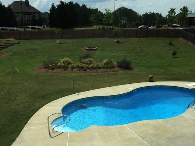 Custom pool with new furniture and toys to enjoy when it's warm.
