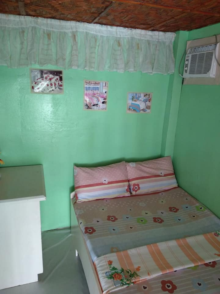 Aircon room w/ common bathroom and toilet
