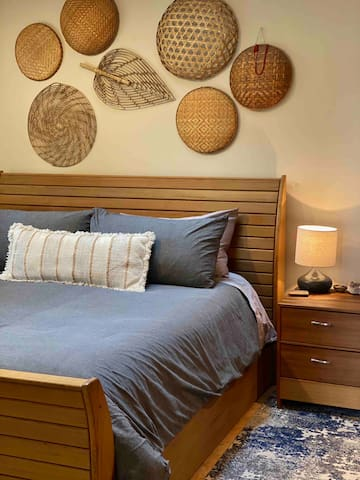 The bedroom has a custom cedar king size bed frame with quality linens and a skylight above the bed (sleep masks are on the dresser if needed).
