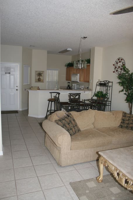 Bright main floor living, dining, kitchen area with laundry and washroom