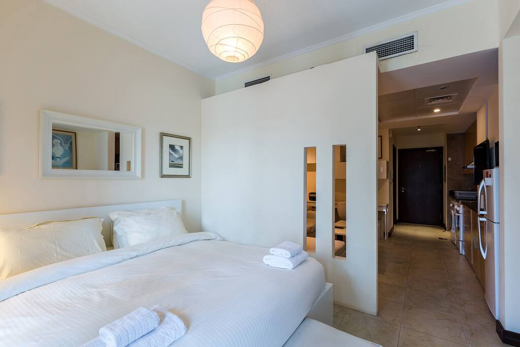 Extremely comfortable king size bed, partitioned from the rest of the studio for privacy
