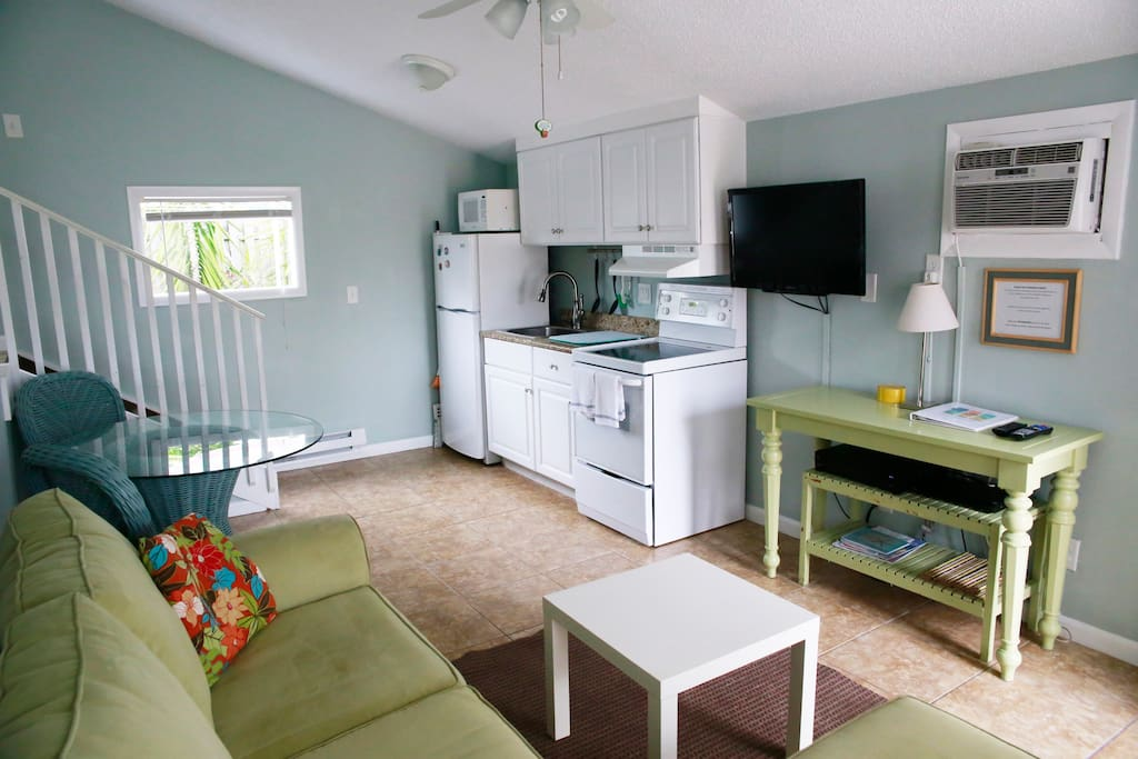 Kitchenette with stove, sink and full refrigerator