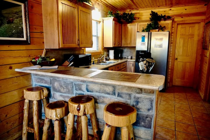 Fully Stocked Kitchen has a Stove, Oven, Microwave, Crock-Pot, Coffee Maker with Coffee, Sugar and Cream included.