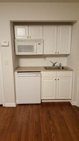 microwave, fridge, also we have cups, plates all silverware, pots and pans, toaster amongst other things.