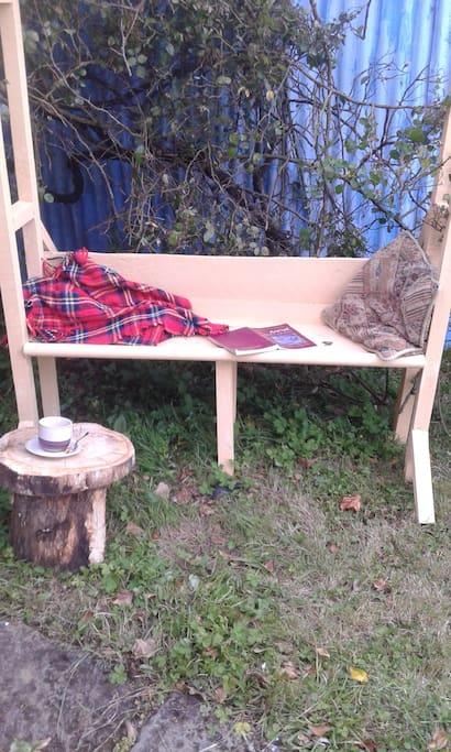Tea chair by the rosebush
