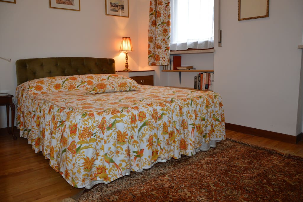 Second bedroom with homely detail including William Morris textiles.