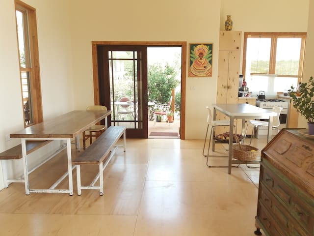 dinning room and kitchen with balcony and exit to the yard