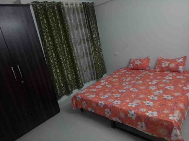 Bedroom 2 with a double bed & ample closet space.