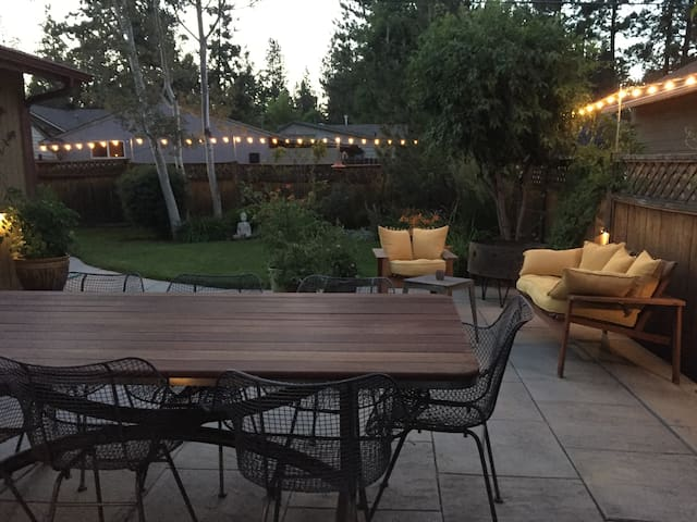 Back patio grilling, dining, relaxing and gorgeous gardens.