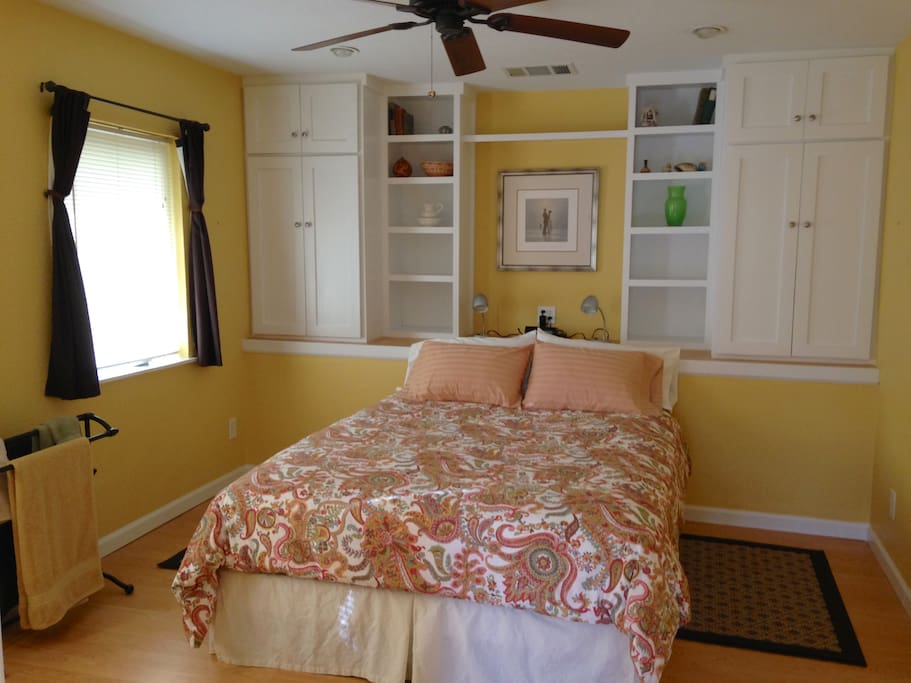 Guest bedroom faces west with 1 queen bed