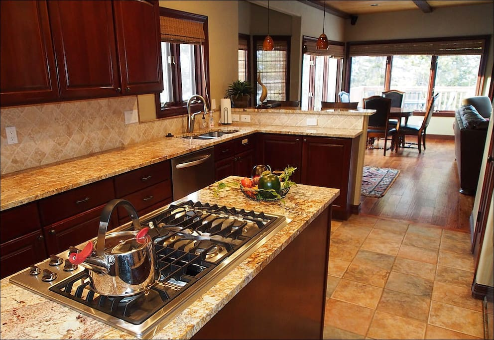 Equipped Gourmet Kitchen with Granite Counter Tops and Stainless Steel Appliances