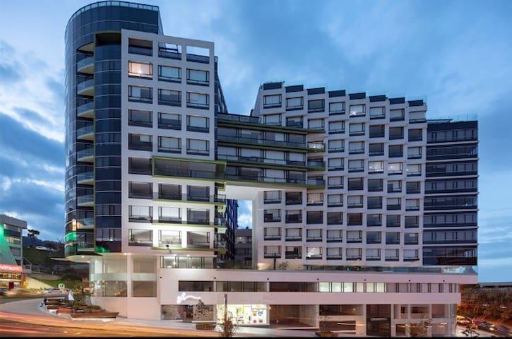 Suit - Edificio Foresta Green Building