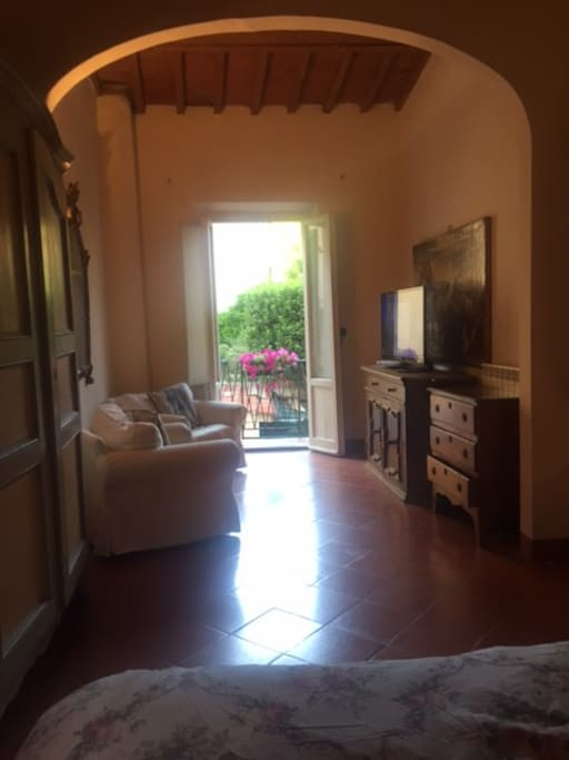 large bedroom with sitting room and TV Lovely view from bed