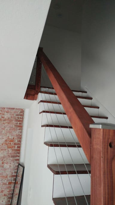 This beautifuly hand crafted stair case leads you to three bedrooms and the upper full bath.