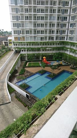 Pool facility + playground for children