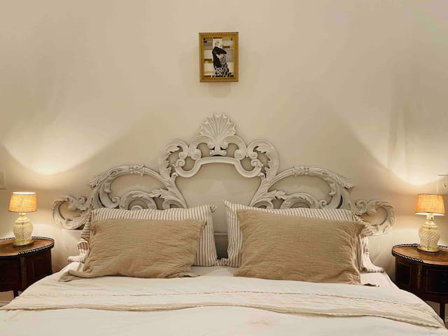 Master bedroom with Italian hand carved wood king size bed