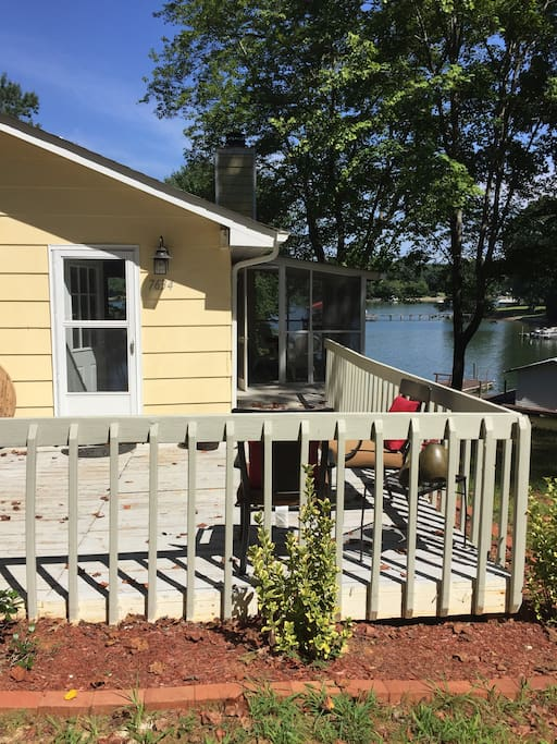 An inviting deck welcomes guests to their stay at The Maine Cottage
