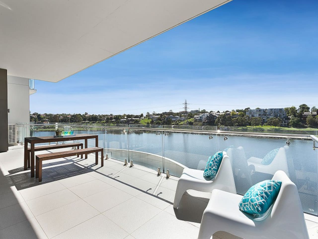 Relax on the large balcony on the waters edge