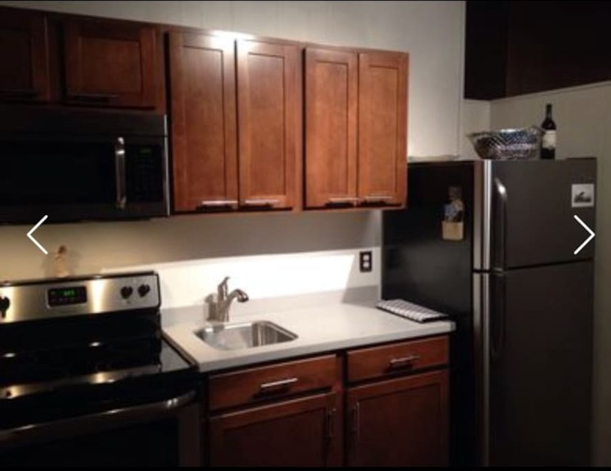 Kitchenette with FULL SIZE fridge, oven, and microwave!