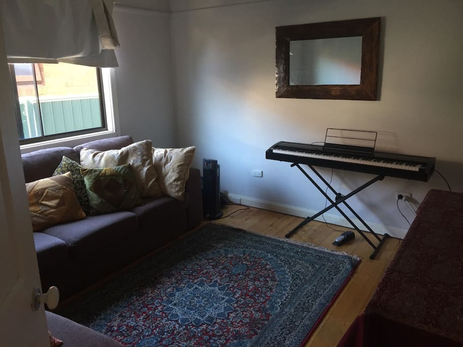 Living room with L shaped couch for extra visitors