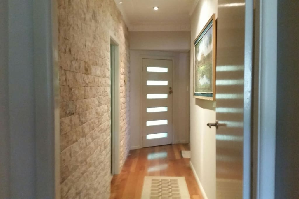 Beautiful guest entrance with stone tiles